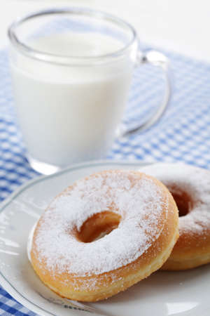 Two iced donuts against the cup of milk photo