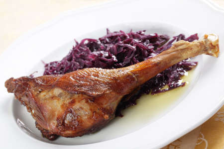 red braised: Roasted goose leg with braised red cabbage Stock Photo