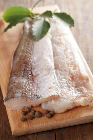 hake: Raw fillet of hake on the cutting board with spices