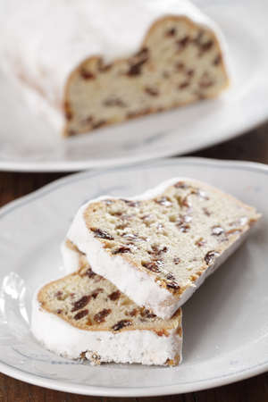 Two pieces of Christmas stollen with raisins closeup photo