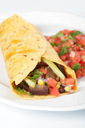 corn tortilla: Burrito with beef meat and vegetables Stock Photo