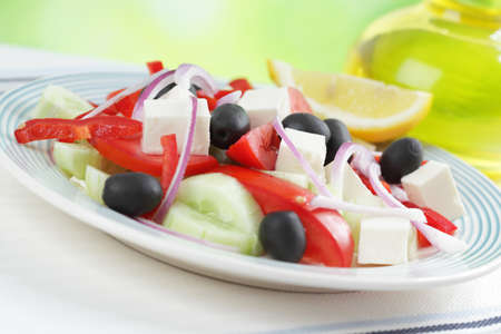 Greek salad on a rustic table closeup photo