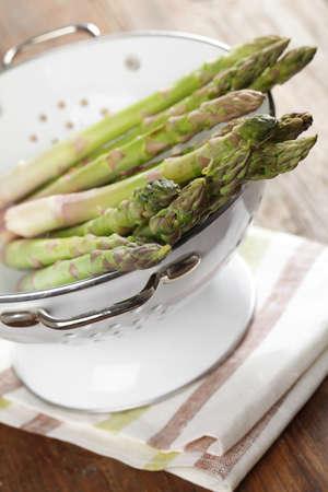 a colander: Fresh asparagus in the colander