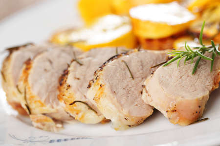 焼きカブと白い皿にローズマリーと豚ヒレ肉 写真素材