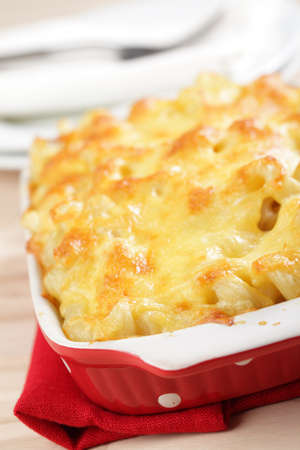 Macaroni and cheese in the casserole closeup photo