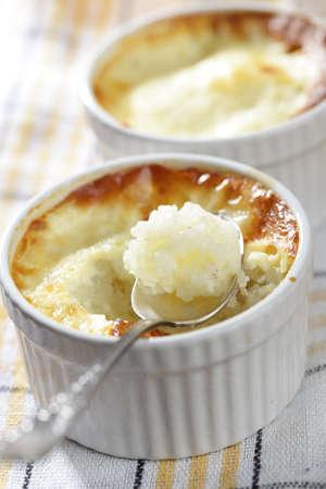 Rice pudding in the ramekin closeup Stock Photo