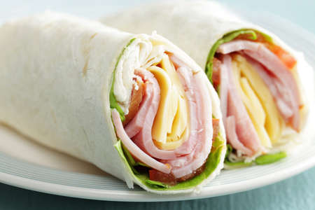 Tortilla roll-ups with ham, cheese, and vegetables