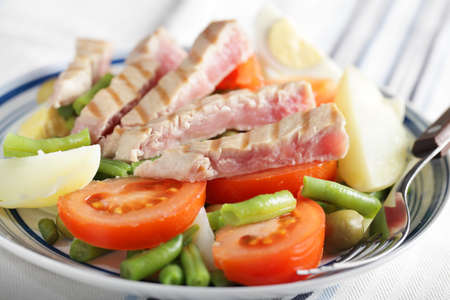 Nicoise salad with tuna and vegetables on the plate photo