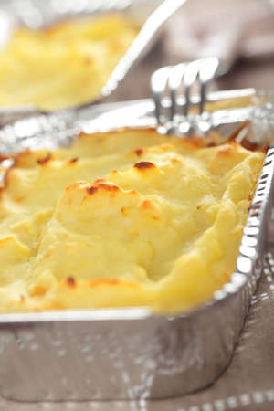 Cottage pie in the aluminum baking dish photo