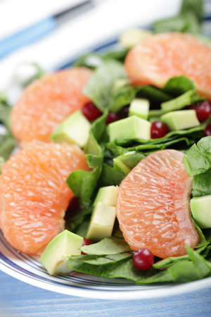 Salad with spinach, grapefruit, avocado, and cranberries photo