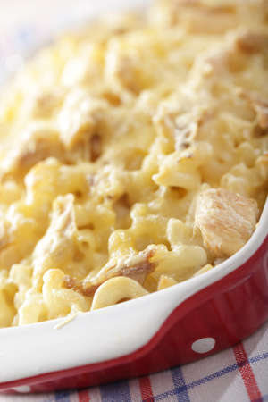 Macaroni and cheese with chicken meat in the baking dish. Shallow DOF photo