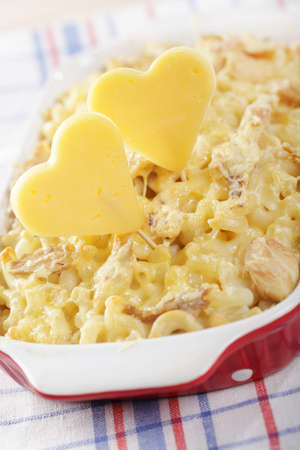 favorable: Cheese hearts in the macaroni and cheese with chicken meat Stock Photo