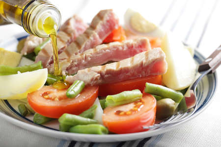 Nicoise salad with tuna and vegetables on the plate Stock Photo