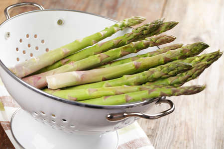 Fresh asparagus in the colander