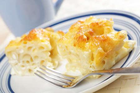 Macaroni and cheese on the plate closeup photo