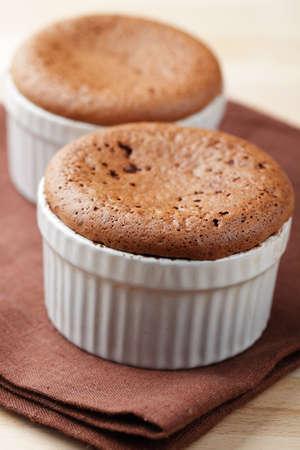 Just baked chocolate puddings in ramekins Stock Photo - 9465640