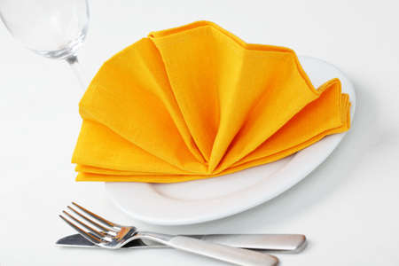 napkin: Table setting with napkin folded as a fan Stock Photo