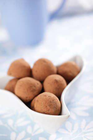 Chocolate truffles in the white bowl closeup