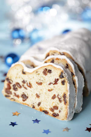 Christmas stollen with raisins closeup against Christmas decorations Stock Photo - 9493919