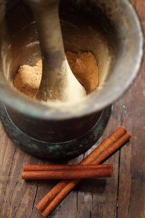 Cinnamon in the rustic mortar photo