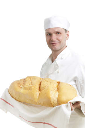 Chef in uniform with big loaf of bread photo