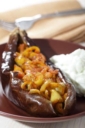 turkish dessert: Turkish dish Imam bayildi with cacik