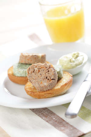 Breakfast with liver pate and green butter on the toasted bun Stock Photo - 9570401