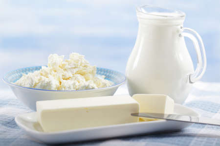 cottage cheese: Butter, cottage cheese, and the jug of milk on the table