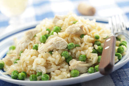 Chicken risotto with green peas on the plate closeup photo