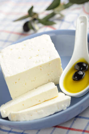 Feta cheese with black olives in olive oil Stock Photo