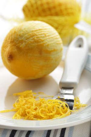 zest: Just scraped lemon zest on the plate Stock Photo