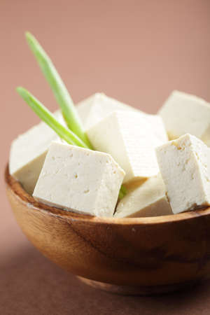 curd: Sliced tofu in the wooden bowl