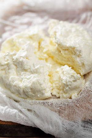 cottage cheese: Ricotta sulla garza closeup