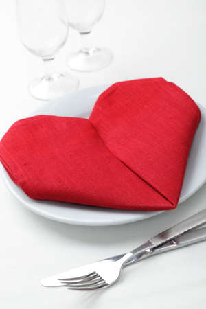 white napkin: Valentines day table setting with heart-shaped napkin