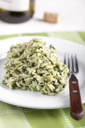 Risotto with spinach on the white plate photo