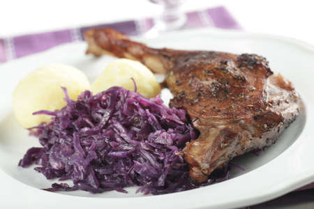 Roasted goose leg with boiled potato and braised cabbage