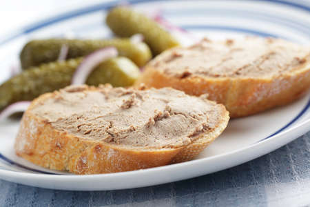 Sandwiches with pate and  pickled cucumbers on the plate