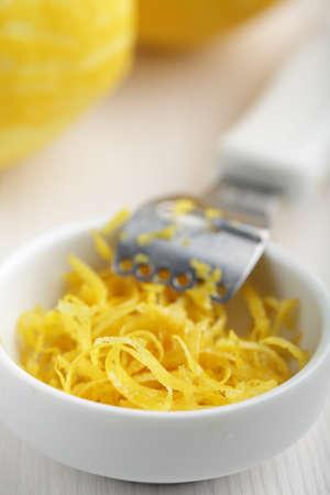 Just scraped lemon zest in the bowl photo