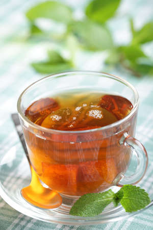 Cup of tea with fresh mint leaves