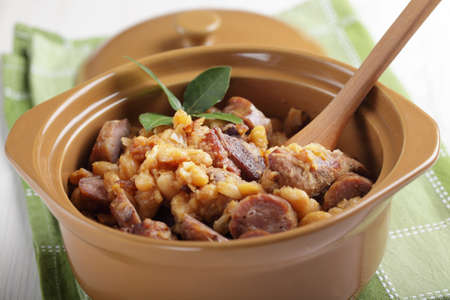 sausage pot: Cassoulet with goose meat, pork sausage, and beans in the pot