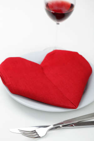 Valentine's day table setting with heart-shaped napkin Stock Photo - 9727689
