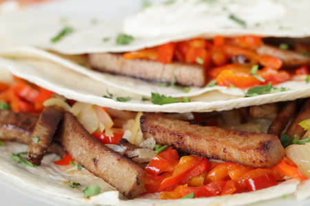 Burritos with meat, pepper, onion and parsley closeup Stock Photo - 9727329