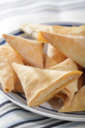 Phyllo triangles with cottage cheese on the plate Stock Photo - 9727651