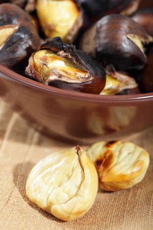 Roasted sweet chestnuts in the brown bowl photo