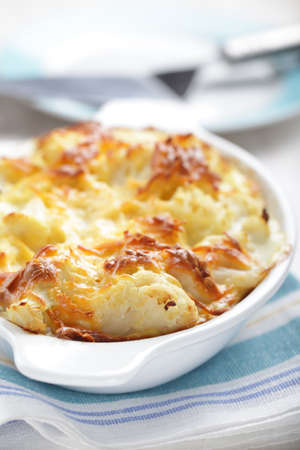 Cauliflower and cheese gratin in the baking dish Stock Photo