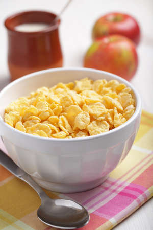 cornflakes: Breakfast with cornflakes, yogurt, and apples