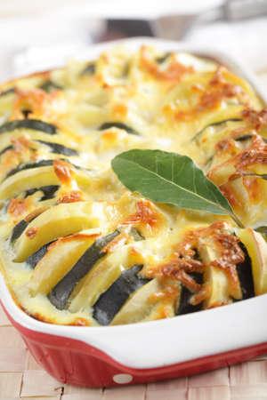 Potato and zucchini gratin in the baking dish