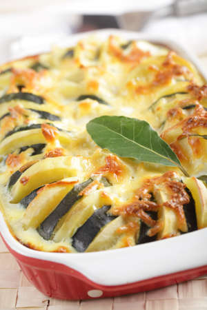 prepared: Potato and zucchini gratin in the baking dish