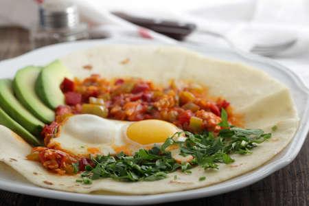 tortilla: Huevos rancheros on the tortilla, the traditional Mexican breakfast dish Stock Photo