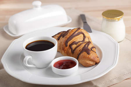 French breakfast with coffee, croissant, jam, butter, and yogurt Stock Photo - 9820265